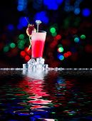 Fresh strawberry cocktail with water reflections and bokeh background