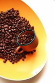 dark roasted ready fresh coffee beans in bulk isolated over white background
