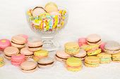 Colorful cookies with cream on table and in glass vase