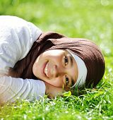 Beautiful Middle Eastern Arabic girl having happy time in nature