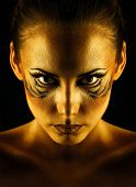 picture of tigress  - Beautiful and dangerous girl tigress with predatory gaze close - JPG