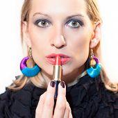 Beautiful lady with a lipstick