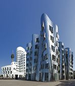 Dusseldorf, Germany - May 1, 2011: Frank O. Gehry's famous distorted buildings at Medienhafen Dussel