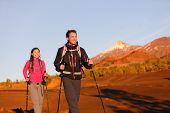 Hikers people hiking - healthy active lifestyle. Hiker couple hiking in beautiful mountain nature la