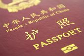foto of passport cover  - close up of Chinese passport isolated on the white background