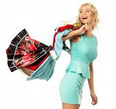 Smiling blond woman choosing clothes