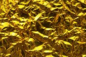 gold abstract background. Gold paper with wrinkles.