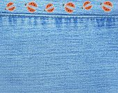 Blue jeans background with ladybugs from rags