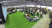 MOSCOW, RUSSIA - JAN 25, 2014: Aerial view to people sitting on soft chairs near the screen at Geek Picnic. Is largest European festival of modern technology, science and art.