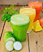 Juice vegetable in three glasses on wooden board