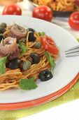 Spaghetti Alla Puttanesca With Olives, Capers And Anchovies