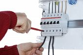 Man Works On Distribution Board