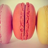 closeup of some appetizing macarons with different colors and flavors, with a retro effect