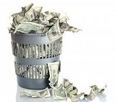 stock photo of money  - Money in dustbin isolated on white - JPG