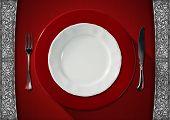 Empty Plate On Red Velvet Background