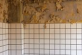 Old Cracked Dilapidated Wall And Ceramic Tiles