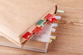 Books with bookmarks on wooden background