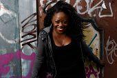 Close Up Happy Black Woman Posing At Wall
