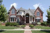 foto of turret arch  - Luxury brick home with turret and arched entry - JPG