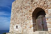 image of safe haven  - Main entry of the Pigeon Island Fortress also known as the Pirates castle in the Kusadasi harbor on the Aegean coast of Turkey - JPG