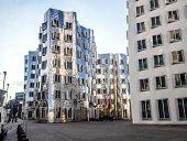 Exterior of futuristic building Neuer Zollhof at Dusseldorf Media Harbor