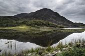 Landscape Image Of Mountain Reflected In Still Lake On Summer Morning