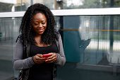 Young African Woman Reading A Text Message