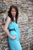 Pretty young brunette model posing for a fashion shoot outdoor