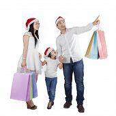 Family With Santa Hat And Shopping Bags
