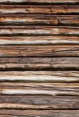 stock photo of log fence  - Wooden logs wall of old rural house background - JPG