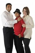 A biracial family of three -- an Asian Indian dad, caucasian mom and their handsome preteen son.  On a white background.
