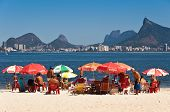 People relaxing in Niteroi beach with view to Rio de Janeiro