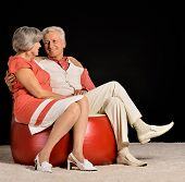 Elderly couple sitting