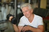 Elderly man in a gym