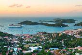 Virgin Islands St Thomas sunrise with colorful cloud, buildings and beach coastline.