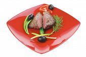 meat food : roasted fillet mignon on red plate with tomatoes apples and chili pepper isolated over w