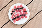 Detailed photo of tasty tuna nigiri sushi ona  wood