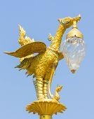 Thai Traditional Beautiful Golden Swan On Street Lamp Post
