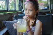 Young Girl Drinking Juice