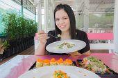 Girl Eat Food In Restaurant