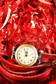 Christmas Composition With Red Baubles And Watch