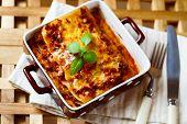 Italian Food. Lasagna Plate With Fresh Basil.