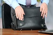 Businessman  Standing Closing  A  Leather Briefcase.