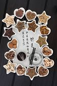 Chinese herbal medicine selection, acupuncture needles and moxa sticks with calligraphy script. Translation describes acupuncture chinese medicine as a traditional and effective medical solution.