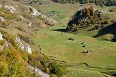 foto of haystack  - Autumn mountain landscape with haystacks in a valley - JPG