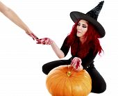 Redhead Witch Reaches A Hand Full Of Blood