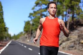 foto of sprinter  - Sprinting runner man running at fast speed - JPG