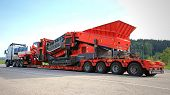 Volvo FH Hauls A Heavy Load On Double Drop Deck Trailer