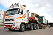 Volvo FH16 Truck Hauls Pile Driver On Double Drop Deck Trailer