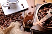 foto of steam  - Coffee grinder with steaming coffee beans in the background top view - JPG